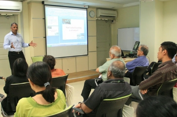 Dr Naidu sharing his views with WOU staff.