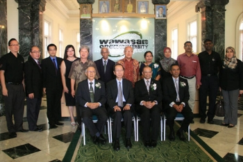 WOU & Perodua top management in group photo.