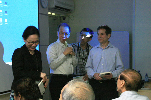 Dr Bong (left) receives a copy of  Einstein's Dreams .