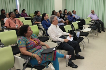 Attendees listen attentively to the talk.
