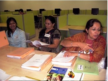 Tutors browse through the comprehensive course materials provided to students.