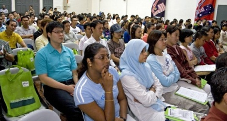 Newly-registered students listen during the orientation.