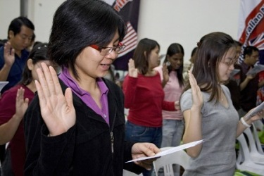 Taking their oath.