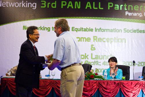 Tengku Azman Shariffadeen handing over the book to Dr Michael Clarke.