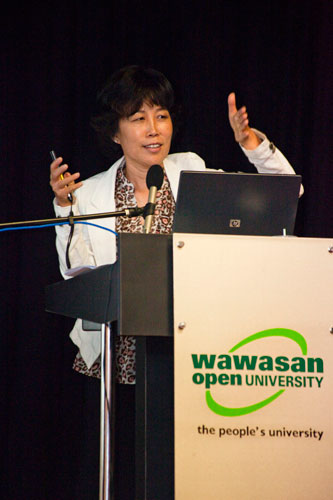 Prof Insung delivers her talk.