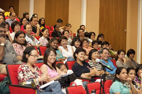 The crowd enjoys the entertaining talk.