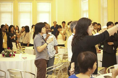 WOU staff raise their cups to toast Prof Dhanarajan.