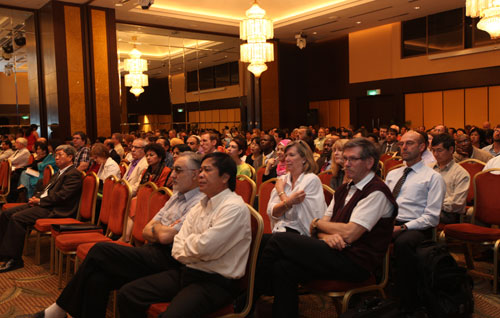 Participants attend the official opening of the conference.