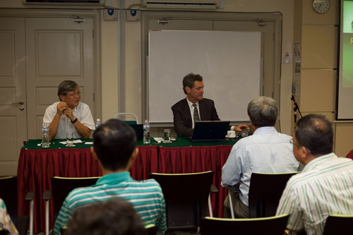 Tan Sri Andrew Sheng (left) chairs the talk by Prof Roland-Holst.