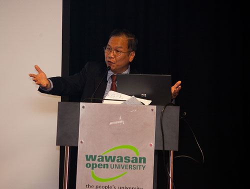 Prof Woo gestures to make a point.