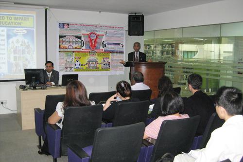 Dr Gandhi presents his talk.