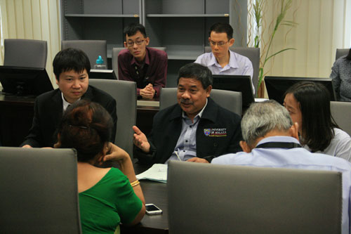 Dr Azarea (centre) and Chen (left) share about the Mandarin course.
