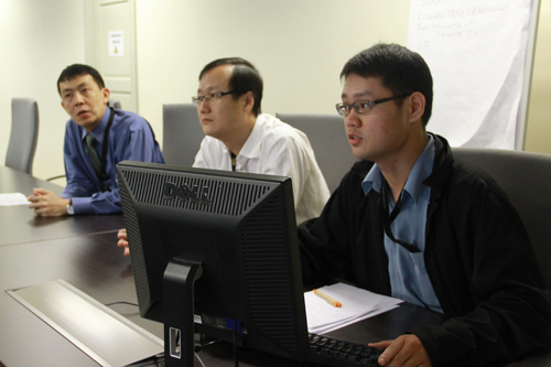 Multimedia specialist David Lee (right) shares on web portals.