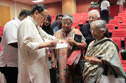 Prof Bose autographs his book. At right is his mum.