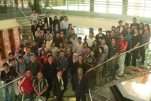 Dr Santhiram (foreground, right) stands next to KCRC Director Jimmy Chai for a group photo with the new students.
