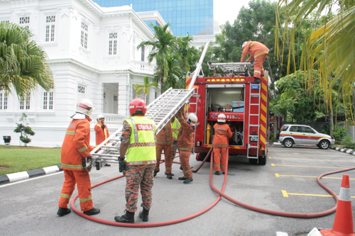 Firefighters in action during the fire drill at the main campus.