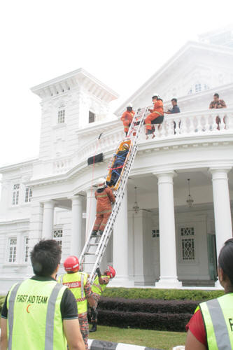 Bringing down Faizal from the burning building.