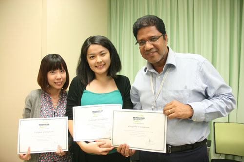WOU staff with their certificate (from left) - Tan Chinq Wei, Teh Lee Mei and R. Ravindran.