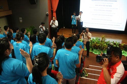 Petrina leads in the oath-taking.