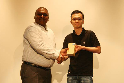 MyEnrolment grand prize winner H'ng receives his prize from Ishan.