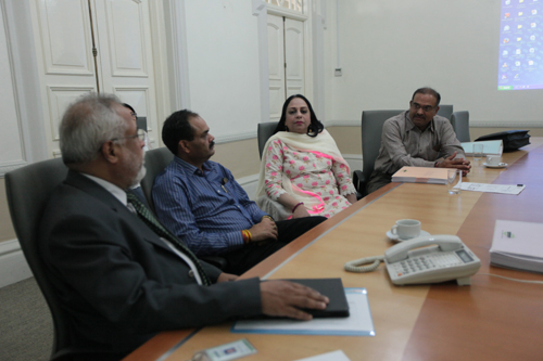 The delegation in discussion with Prof Mohandas Menon (left).