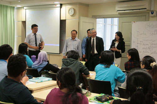 The delegation drop in on a lecture in progress for the full-time students.
