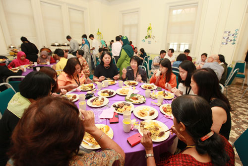 Staff mingle as they enjoy the luncheon.