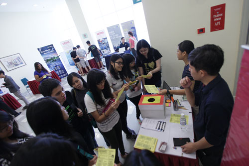 An exhibitor entertains queries from the students.
