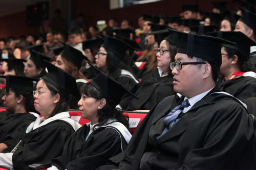 Graduates seated in the hall.