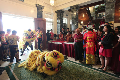 The lion dance performance and God of Prosperity inside the Homestead.