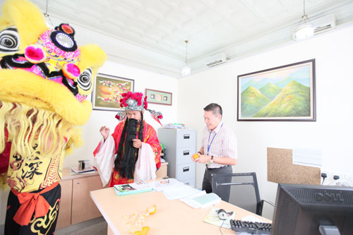Blessing the office of K H Chong, Director of Marcom and Regional Operations.