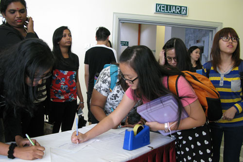 Full-time students register their attendance for the annual general meeting held at the main campus.