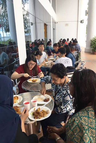 Staff and students enjoy good company and good food by the sea.