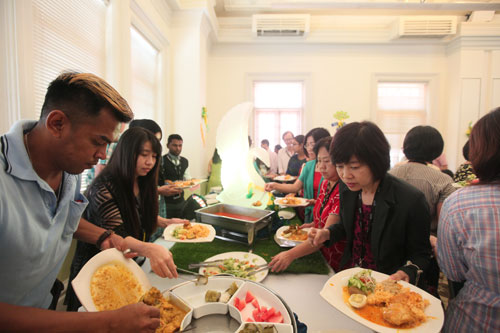 Happy feasting and mingling by staff.