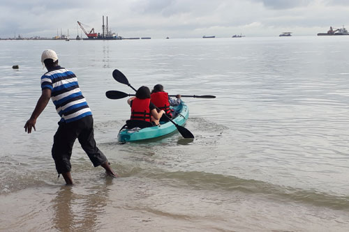 Ch'ng Lay Kee, a staff of Wawasan Open University, and guest venture out to sea in a kayak.