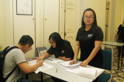 Team members from the DECE programme help out with registration.