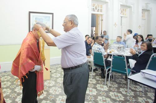 Prof Santhiram bestows a garland on Prof Ho.