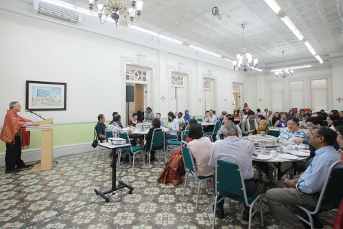 Dr Nagarajan (foreground, seated at right) and other staff listen to Prof Ho.