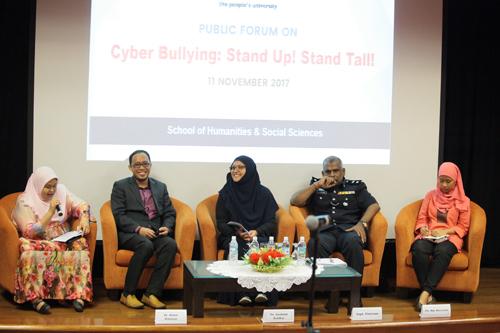 WOU Lecturer Irmadura Ramli (left) introduces the four panellists.