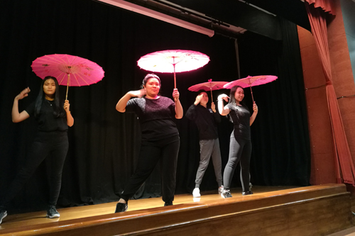 The umbrella dance by four full-time students, three ladies and a guy.