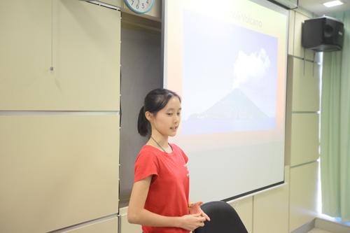 Grace evokes the audience interest on volcanoes.
