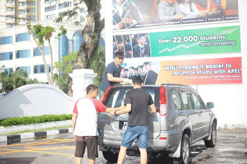 The students attacking the car wash duties with gusto.