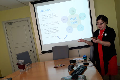 Grace lau reads some of the student queries received through moodle mobile app.