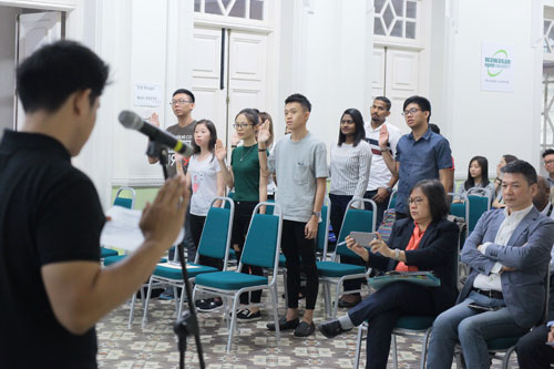 Muhammad Danial leads in reciting the students' pledge.