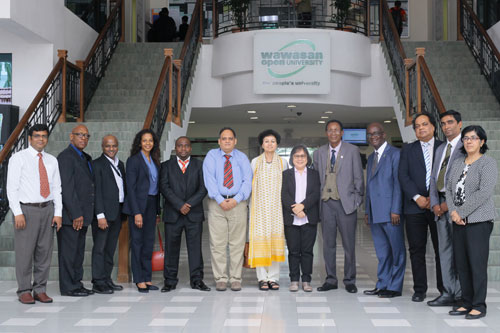 Acting WOU Vice Chancellor Prof Zoraini Wati Abas (centre) with the AB members and the COL delegates.
