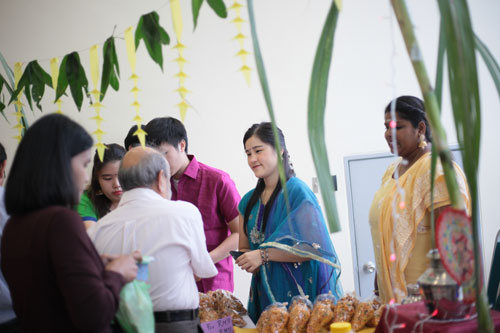 Staff checking out the foods sold at the Hinduism corner.