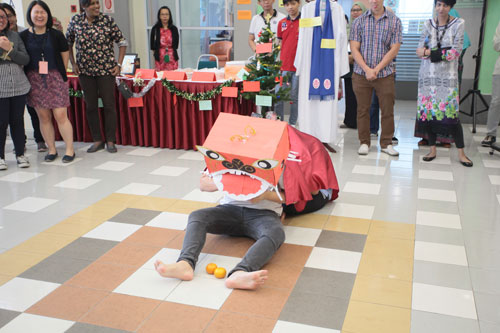 Being creative - the students perform a simple, improvised lion dance.