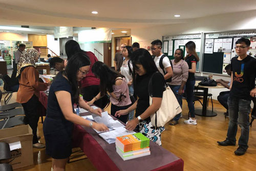 The new students register for orientation at the Kuala Lumpur Regional Centre.