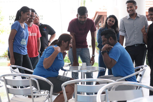 Rina Julian (left) and Sasikanth obeying instructions as the wait to grab the cup first on command.