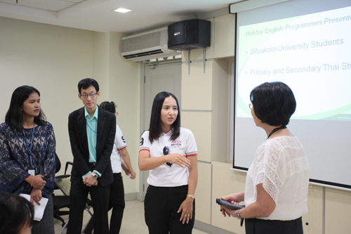 Juthaporn (2nd from right) expresses interest in the Holiday English classes.